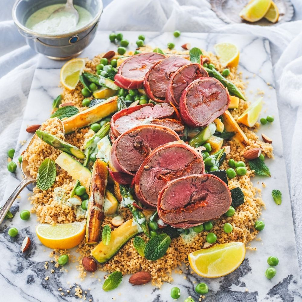Prosciutto Wrapped Lamb Rumps with Warm Spring Salad on Moroccan Couscous